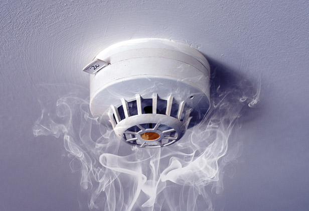 Smoke alarm with smoke around it